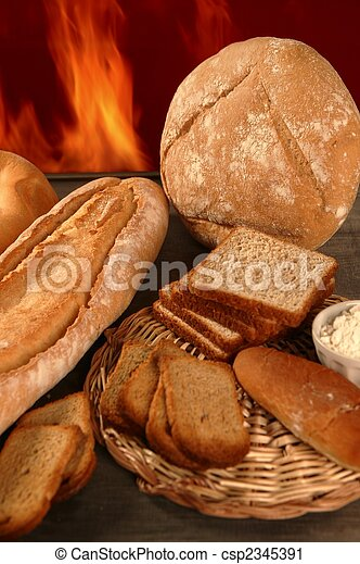 Bread still life with varied shapes and bakery fire - csp2345391