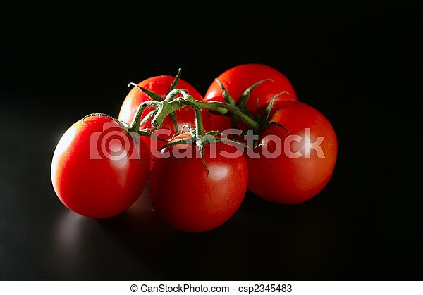 Cluster red tomato over black - csp2345483