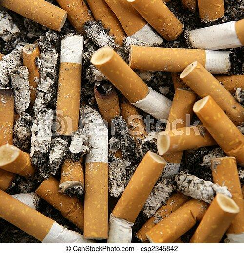 cigarettes texture, busy ashtray square still shot - csp2345842