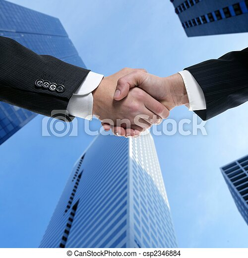 Businessman partners shaking hands with suit - csp2346884