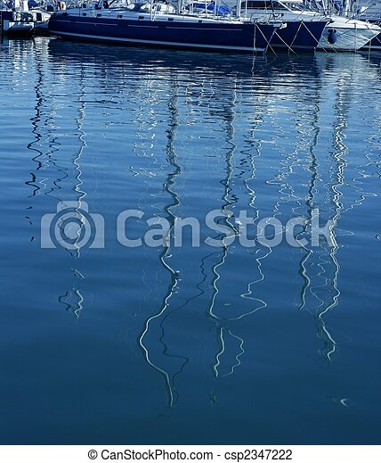 Boats abstract reflexion over blue water - csp2347222