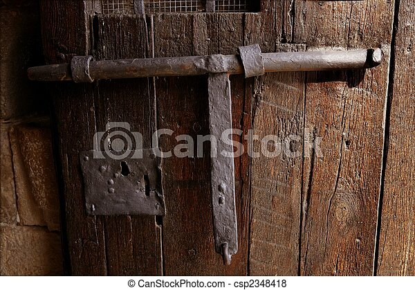 Old medieval lock on wooden castle door - csp2348418