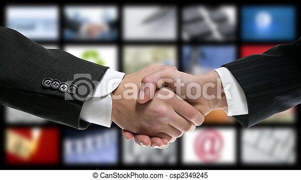 handshake over video tv screen technology - csp2349245