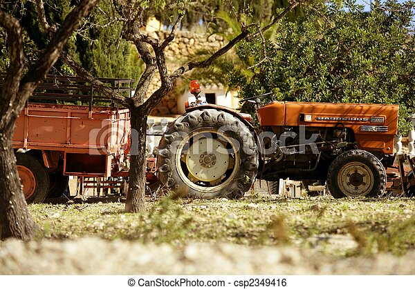Old rusted tractor orange color in Spain - csp2349416