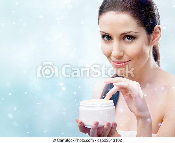 Woman starting to apply moisturizing mask