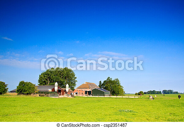 Countryside with farm and cows on a grassland - csp2351487