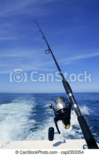 Fishing rod and reel on boat, fishing in blue ocean