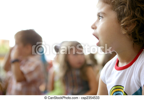 Spectator children looking at the show - csp2354533