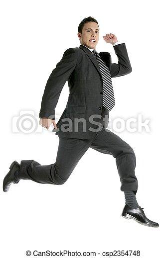 Businessman jumping at studio, full on white - csp2354748