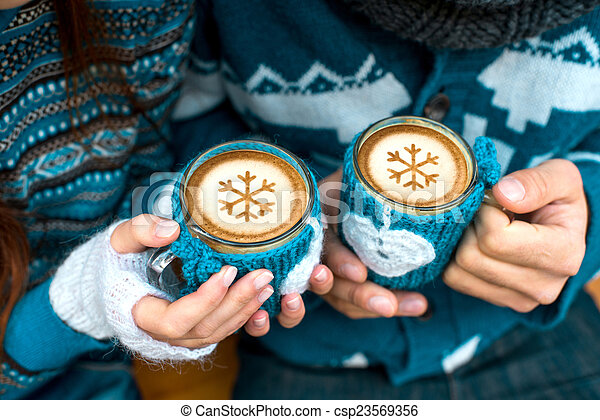 Couple with coffee cups in winter