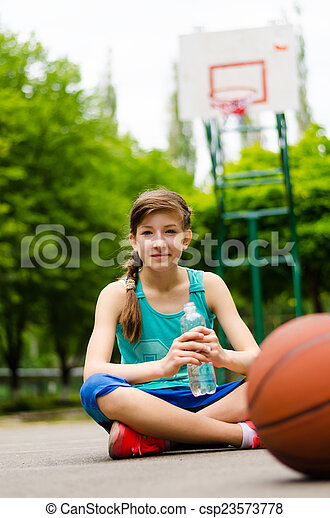 Sporty young girl on a basketball court