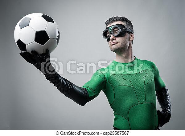 Superhero with soccer ball - csp23587567