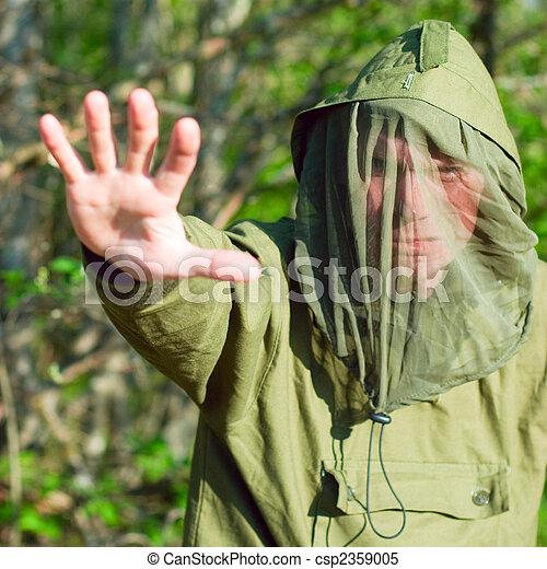 Man in encephalitis protective clothing - csp2359005