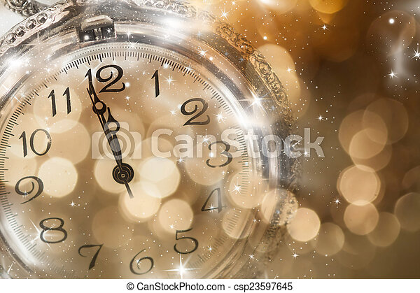 New Year\'s at midnight - Old clock and holiday lights