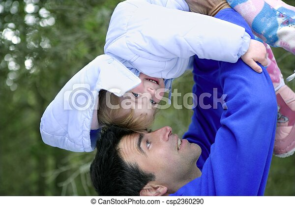 Father winter upside down daughter  outdoors - csp2360290