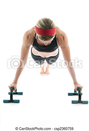 attractive middle age female fitness trainer exercising push ups fitness push up bars front view - csp2360759