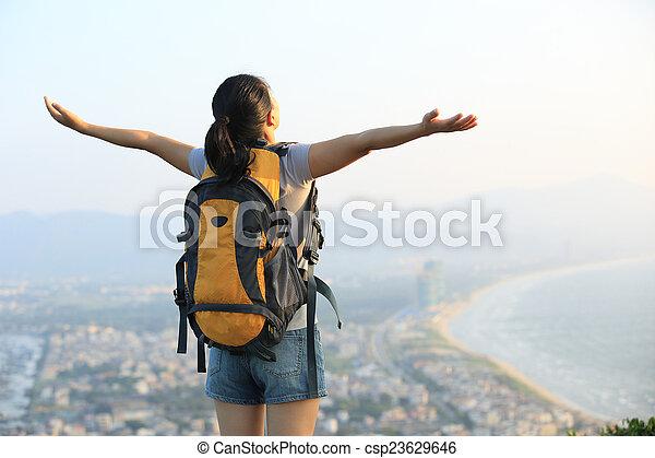 cheering asian woman hiker winning