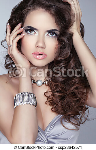 Fashion Woman Beauty Portrait. Makeup. Long wavy shine hair. Bru