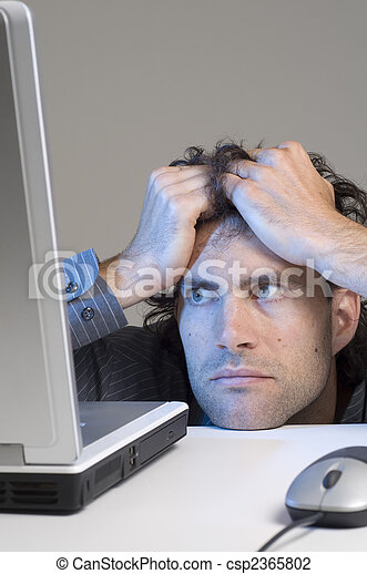 man looking at computer in desperation - csp2365802