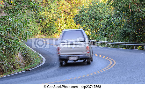Blurred car on the forest road