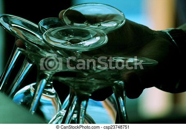 Stock Images of Restaurant bar waiter hand holding wine glasses ...
