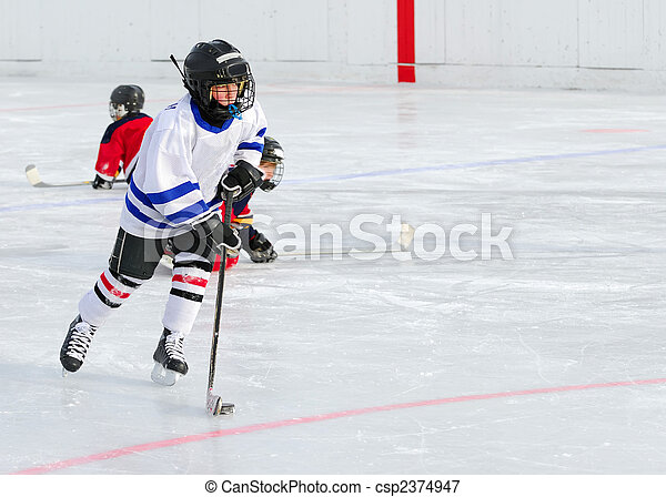 Hockey Player in Action - csp2374947