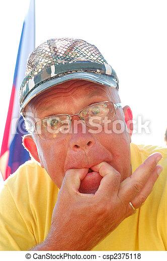 whistling senior man - csp2375118
