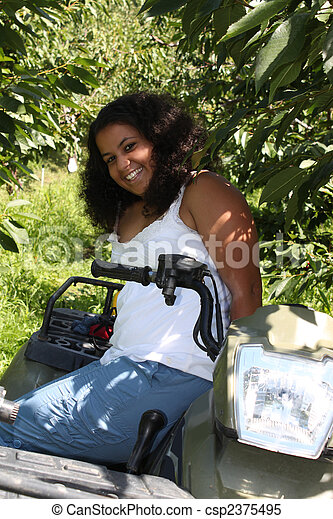 Girl on 4 wheeler - csp2375495