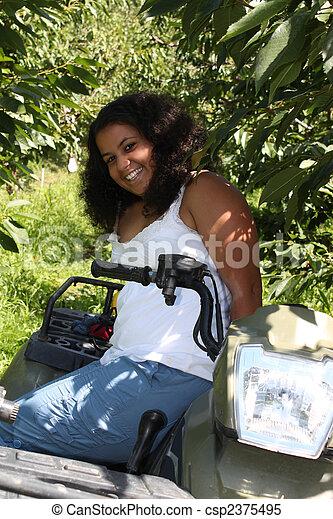 Girl on 4 wheeler - csp2375495