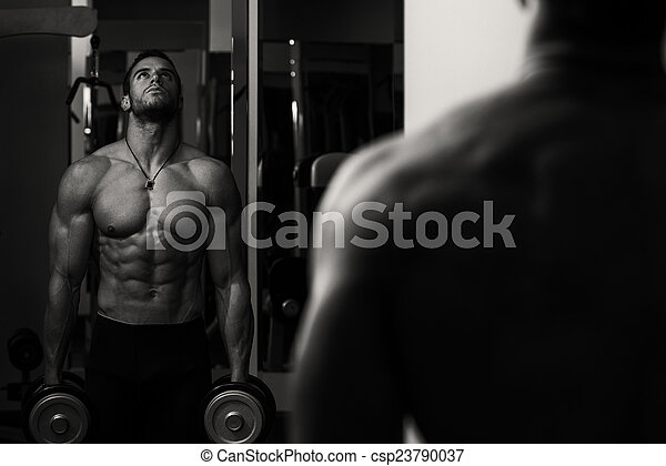 Male Athlete Doing Heavy Weight Exercise For Biceps