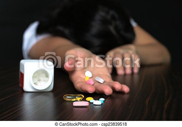 Women overdose pilss - csp23839518