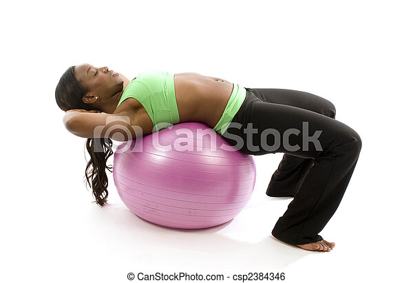 young and pretty hispanic latina black woman trainer wearing exercise tights and working out sit ups with fitness core ball - csp2384346