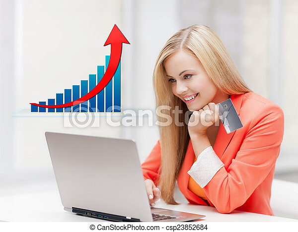smiling woman with laptop computer and credit card