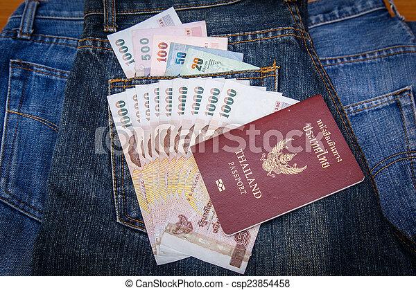 Thailand Passport and money in denim jeans pocket