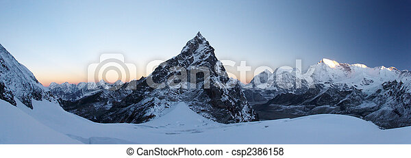 Rocky summit at sunrise panorama, Himalaya, Nepal - csp2386158