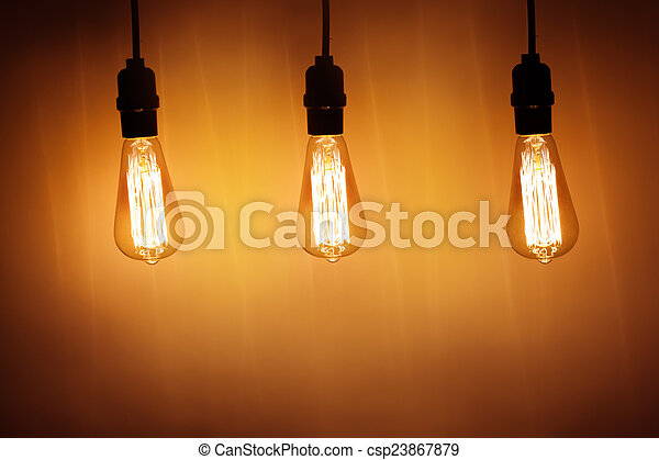three vintage bulb lamps with warm light