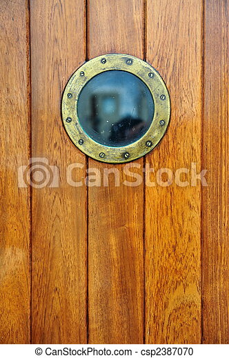 an antique doorway with porthole - csp2387070