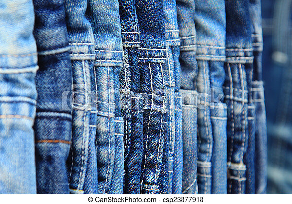 Row of hanged blue jeans - csp23877918