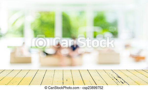 Empty wood table and blurred living room background.
