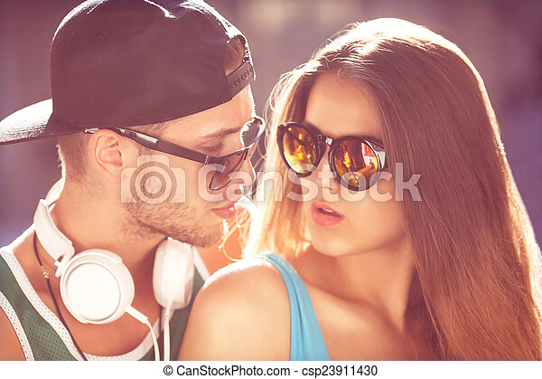 Close up portrait of happy smiling hipster couple in love. Weari