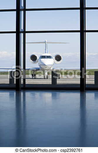 Private Corporate Jet at An AIrport Terminal - csp2392761