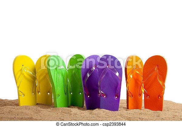 Colorful Flip-Flop Sandles on a Sandy Beach - csp2393844