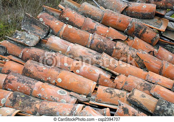Collapsed terra cotta tile roof - csp2394707