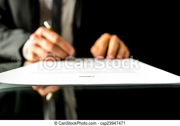 Businessman signing a document with focus to the text Contract