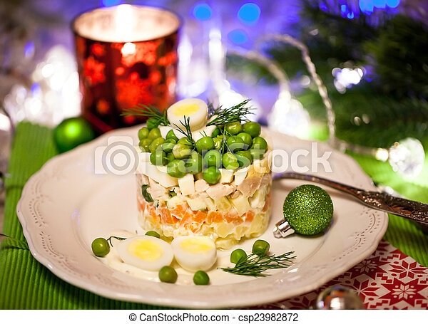 Russian traditional salad Olivier, on holiday background