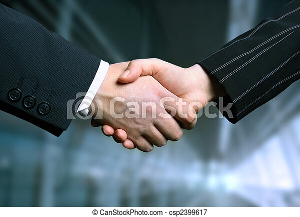 business hand shake and a office in background - csp2399617