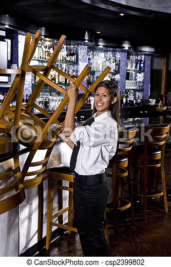 Bartender in closed bar - csp2399802