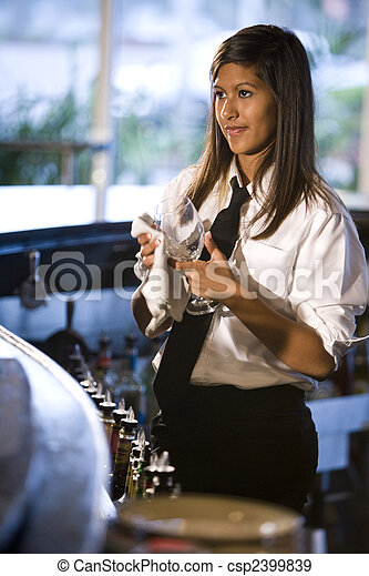 Bartender cleaning a wine glass - csp2399839
