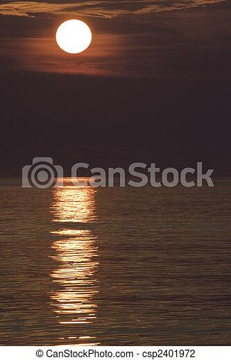 Sunrise over ocean waves vertical - csp2401972
