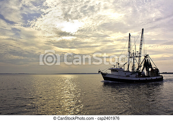 Fishing trawler on the water at sunrise - csp2401976